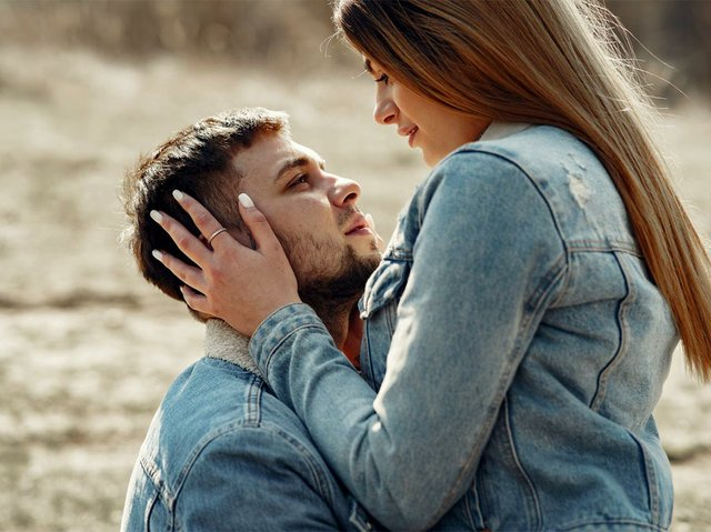 loving-couple-hugging-on-field-in-countryside-4005088.jpg