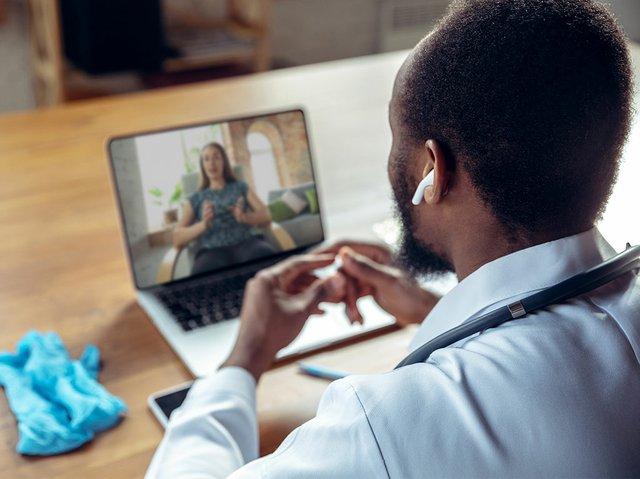 doctor-advising-patient-online-with-laptop.jpg