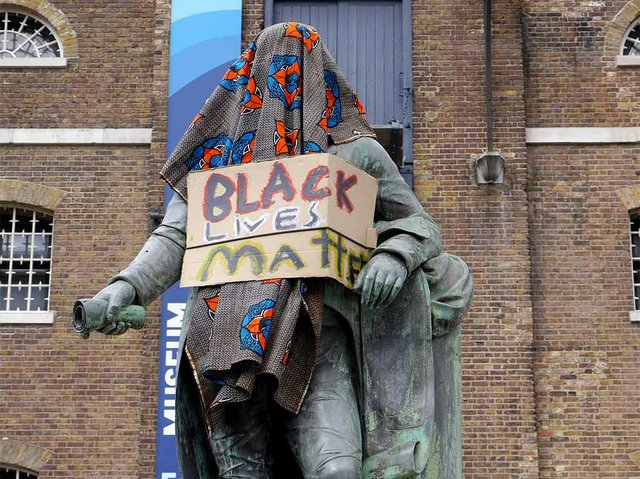 Statue_of_Robert_Milligan,_West_India_Quay_on_9_June_2020_-_statue_covered_and_with_Black_Lives_Matter_sign_photo-by-Chris-McKenna--(CC-BY-SA-4.0).jpg