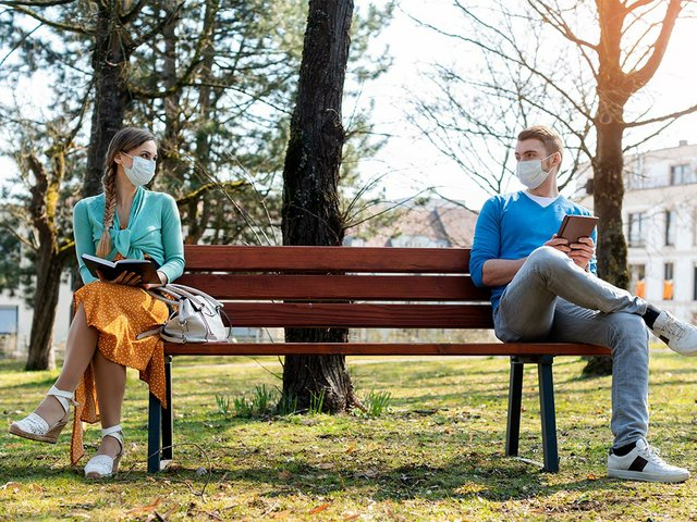 woman-man-social-distancing-sitting-bench.jpg