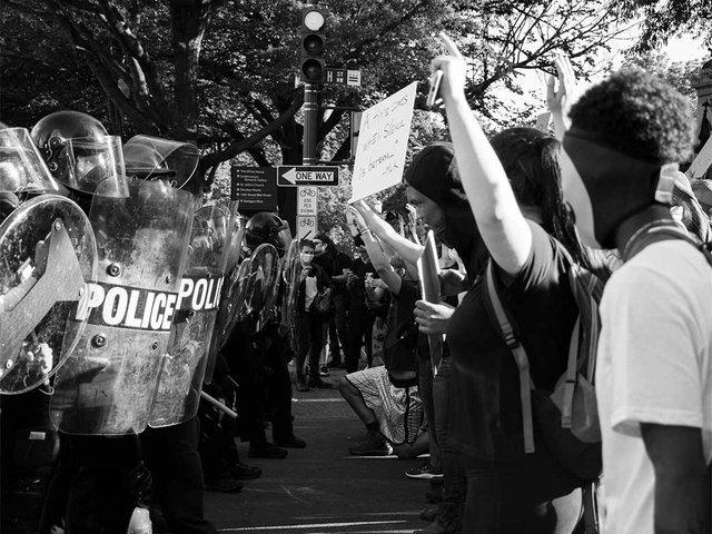 police-facing-line-of-protestors.jpg