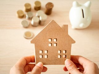 house-held-hands-woman-planning-save-money-invest-real-estate-saving-investing-home.jpg