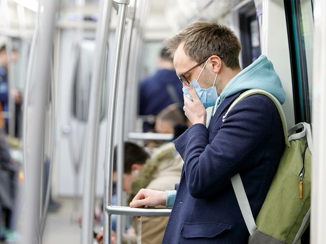 man-glasses-coughing-wearing-protective-mask.jpg
