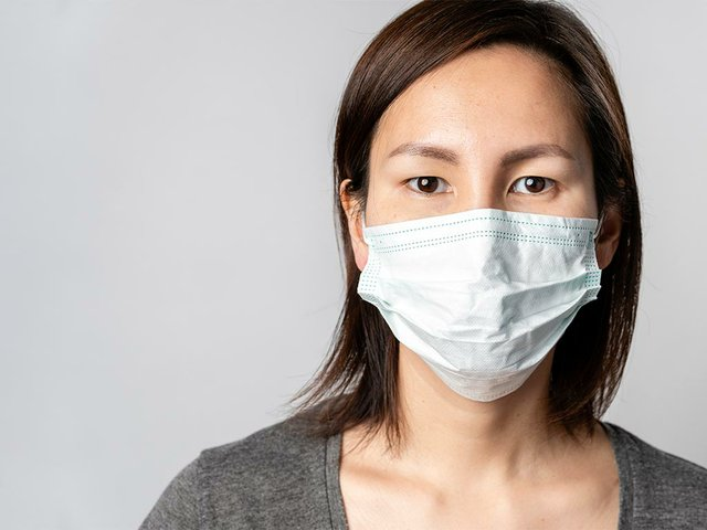 portrait-adult-woman-with-surgical-mask.jpg