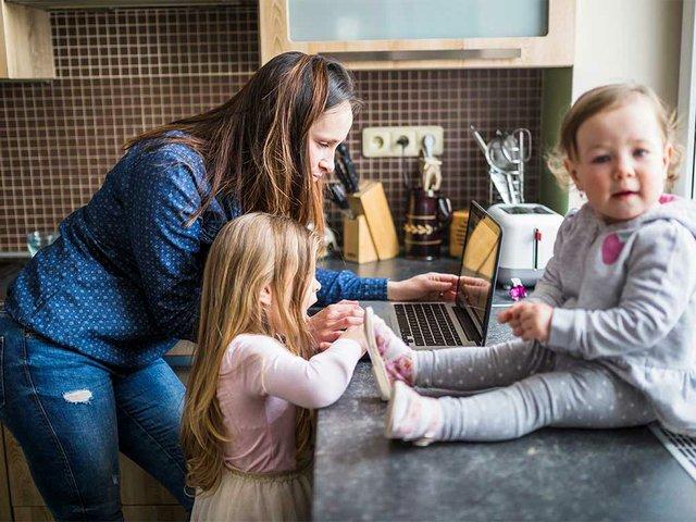 mother-with-her-children-using-laptop-kitchen.jpg
