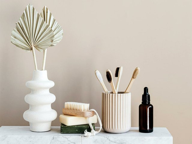 set-of-natural-toiletries-on-marble-table-in-bathroom-4202918.jpg