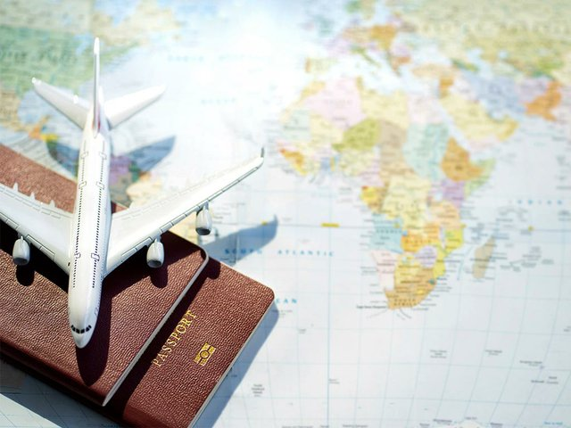 passport-with-map-background-travel-concept.jpg