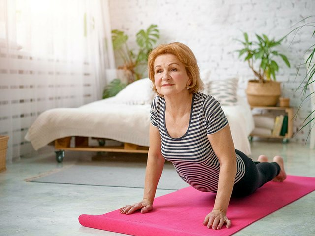 senior-woman-exercising-home-concept-healthy-lifestyle-fitness-yoga.jpg
