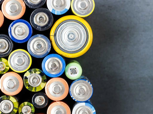 used-alkaline-batteries-different-size-black-background.jpg