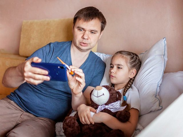father-looking-screen-smartphone-consulting-with-doctor-online-home2.jpg