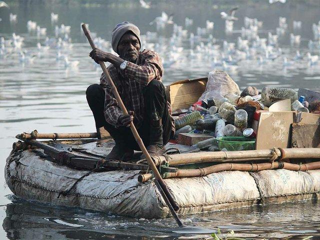 waste-picker-on-boat.jpg