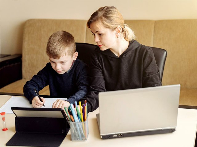 mother-using-laptop-tablet-teaching-with-her-son-online-home-his-room2.jpg