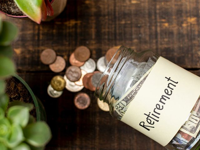 retirement-label-jar-filled-with-money-top-view.jpg