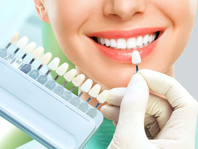 close-up-portrait-young-women-dentist-chair-check-select-color-teeth-dentist-make2.jpg