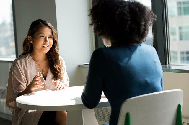 two-women-talking-at-work.jpg