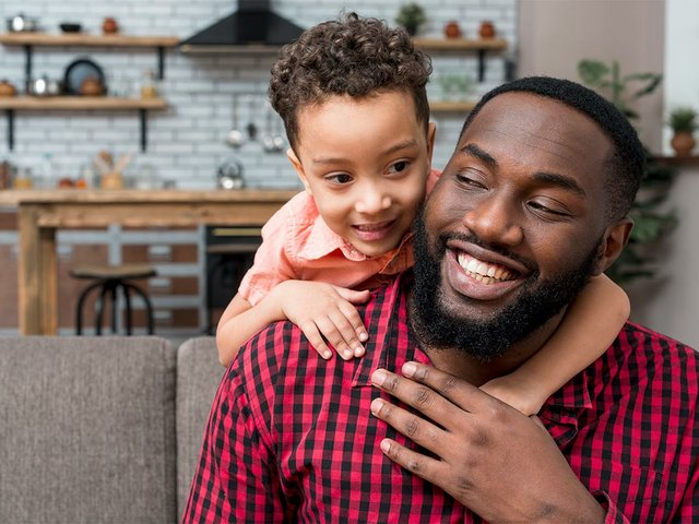 black-son-hugging-father-from.jpg