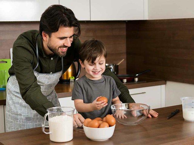 high-angle-smiley-father-son-cooking.jpg
