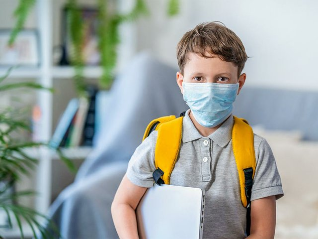 small-schoolboy-wears-mask-protection-during-crown-virus-flu.jpg