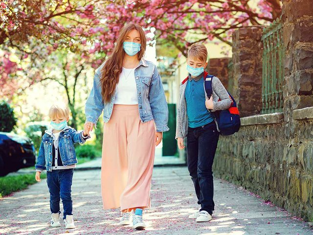 mother-pupil-primary-school-go-hand-hand-sad-family-going-home-during-quarantine.jpg