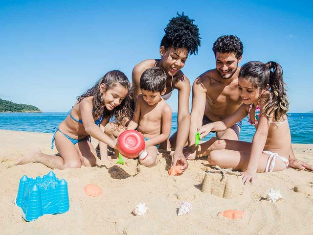 family-playing-with-sand.jpg