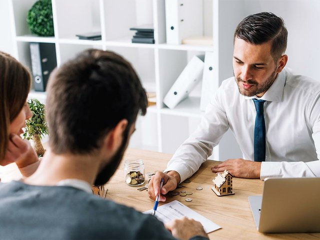 couple-consulting-with-insurance-broker.jpg