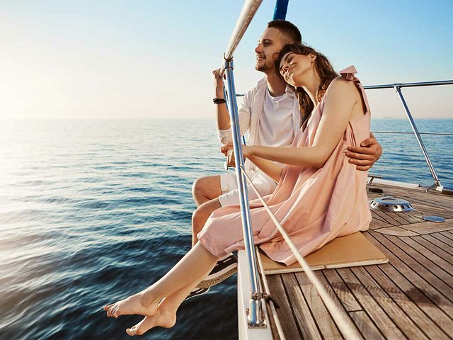 happy-beautiful-adult-couple-sitting-side-yacht-watching-seas.jpg