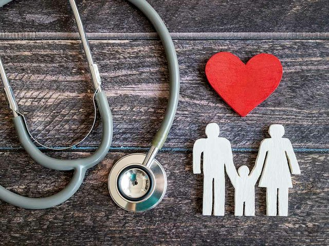red-heart-stethoscope-icon-family-wooden-desk-medical-insurance-concept(2).jpg