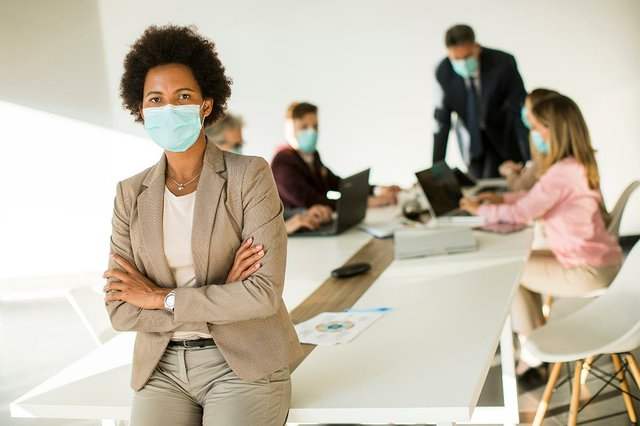 woman-office-wear-mask-as-protection-from-coronavirus.jpg