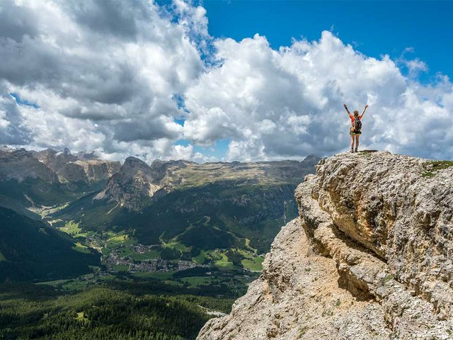 woman-hiking-mountain-top-hands-up.jpg