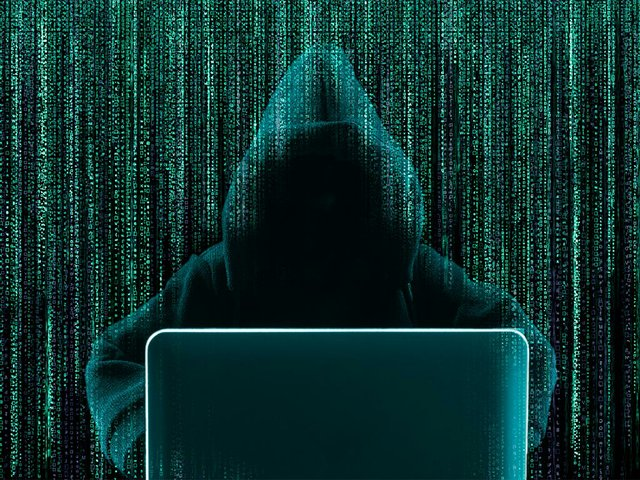 hacker-using-laptop-with-abstract-binary-code.jpg