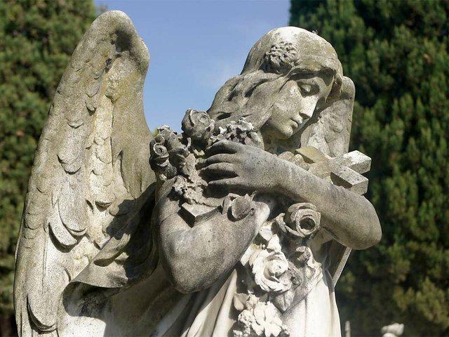 angel-statue-holding-flowers-and-cross.jpg