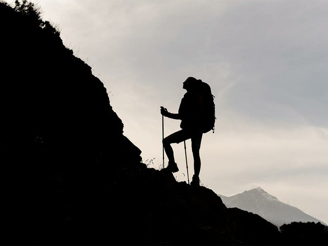 silhouette-woman-standing-rocks-with-hiking-backpack.jpg