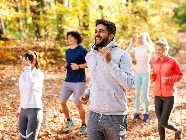 five-cheerful-runners-sportswear-running-forest-autumn-fitness-nature.jpg