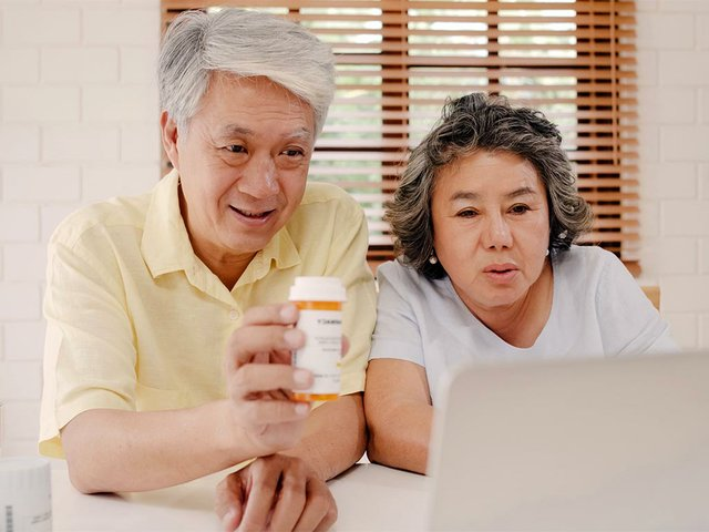 asian-elderly-couple-using-laptop-conference-with-doctor-about-medicine-in.jpg