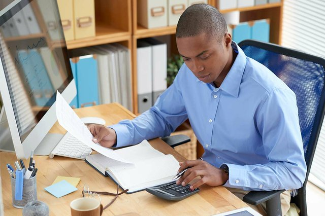 high-angle-view-male-accountant-checking-document.jpg