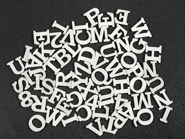 letters-english-alphabet-arranged-chaotic-order-black-space.jpg