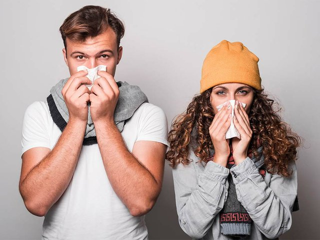 portrait-couple-blowing-their-nose-with-tissue-paper.jpg