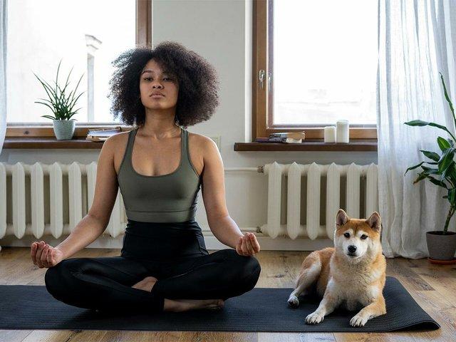 woman-doing-yoga-with-dog.jpg