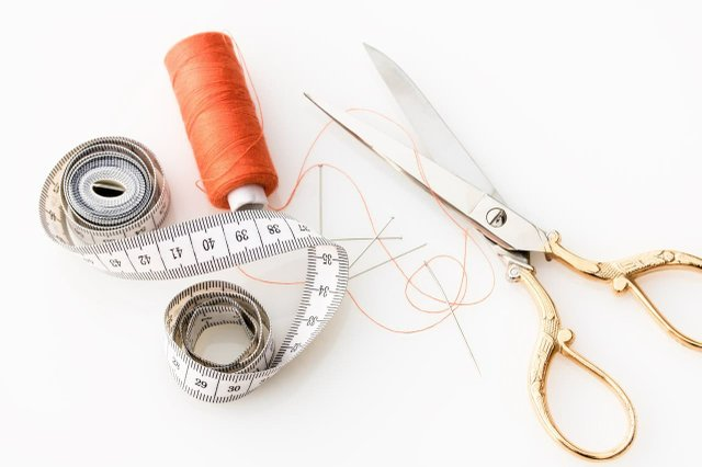 gold and silver scissors-orange thread and white tape measure.jpg