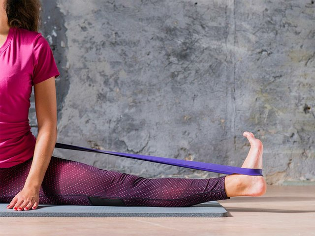 fitness-woman-stretching-workout-resistance-band.jpg