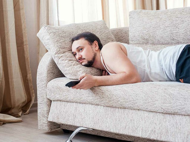 young-unshaven-guy-lazily-resting-tracksuit-sofa.jpg