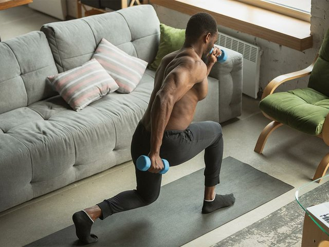 young-man-training-home-doing-exercises-fitness-aerobic.jpg