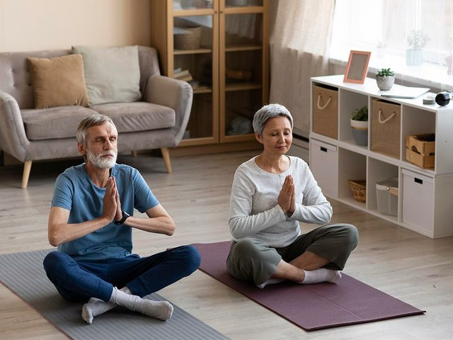 senior-couple-exercising-at-home.jpg