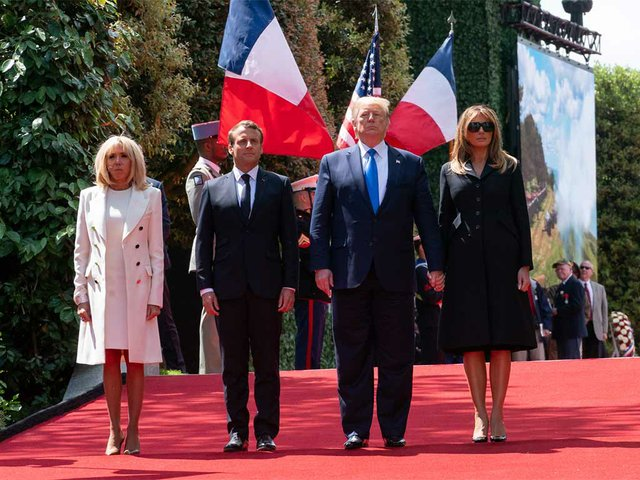 President-Donald-J-Trump-and-First-Lady-Melania-walk-with-French-President-Emmanuel-Macron-and-wife-Mrs.-Brigitte-Macron,-en-route-to-the-Omaha-Beach-overlook-Thursday,-June-6,-2019-photo-by-White-House-Public-Domain.jpg