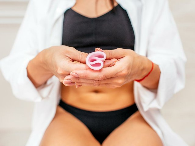 woman-black-underwear-holding-pink-menstrual-cup-her-hand-sitting-toilet-selective-focus-another-option-.jpg