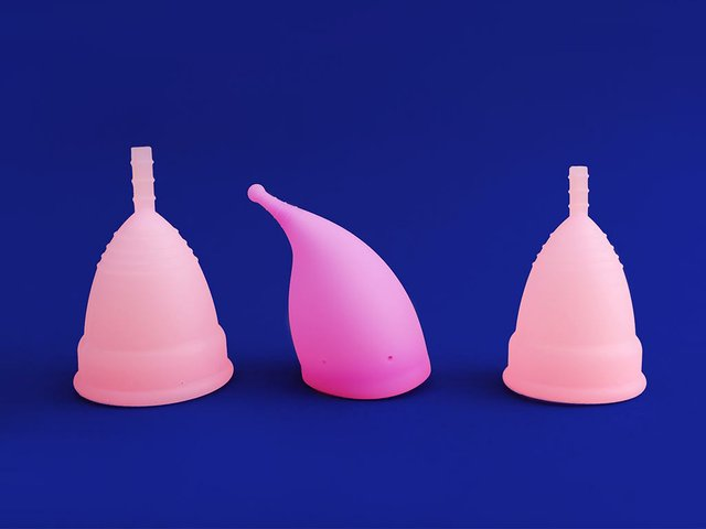 three-different-pink-reusable-silicone-menstrual-cup-isolated-blue-concept.jpg
