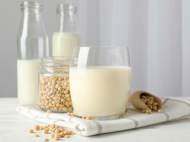 soy-milk-soy-beans-seeds-bottle-with-milk-white-space-text.jpg