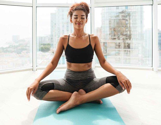 calm-woman-yoga-exercise-home.jpg
