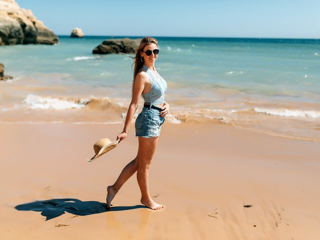 beach-vacationl-woman-sunhat-enjoying-perfect-sunny-day-walking-beach.jpg