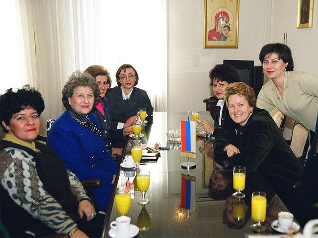 President-of-Republika-Srpska-Biljana-Plavsic-(second-from-left)-–-later-an-indicted-war-criminal-–-at-the-table-in-her-Banja-Lika-office-(CC-BY-2.0).jpg